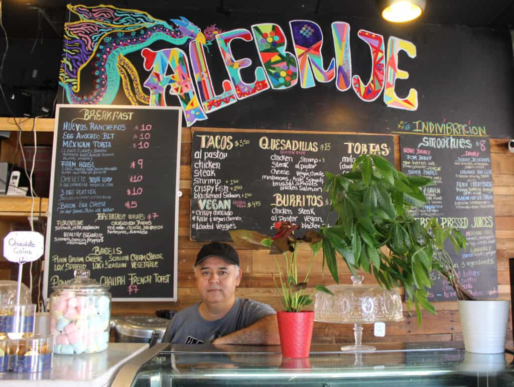 Roberto Jimenez standing behind the counter at Alebrije Mexican Restaurant & Cafe